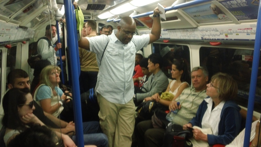 Robert sharing the Gospel on the Tube.