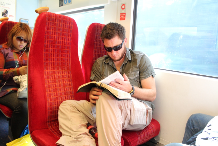 Studying a bit on the train on the way to worship in London.