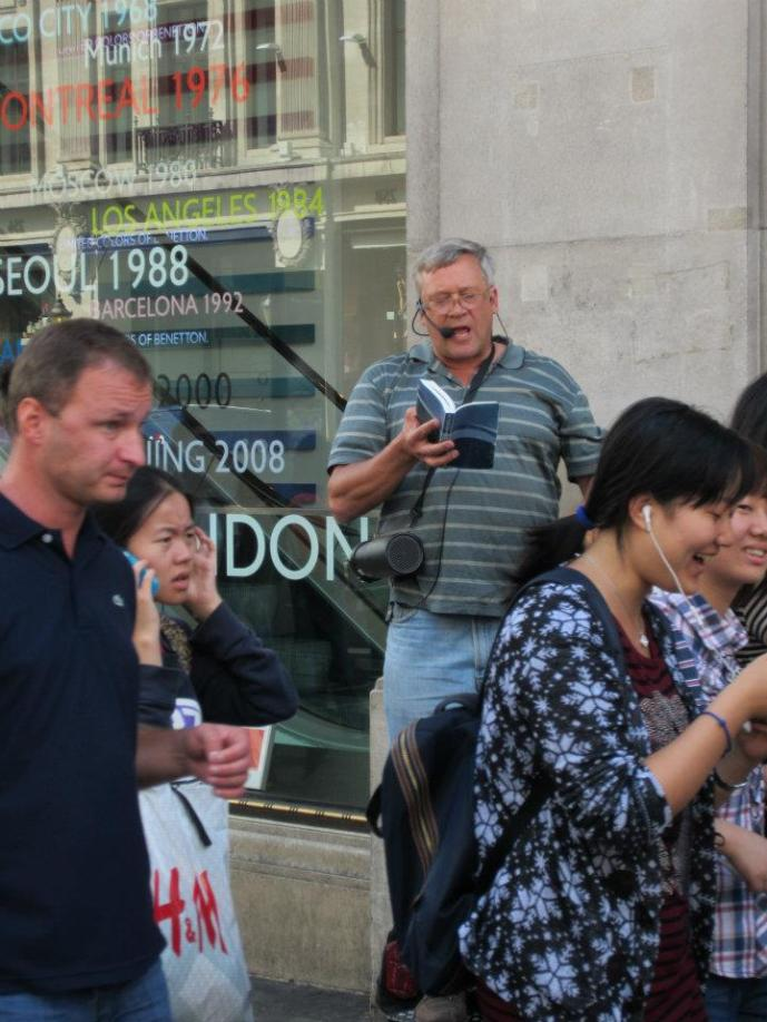Scott preaching in Oxford Circus.