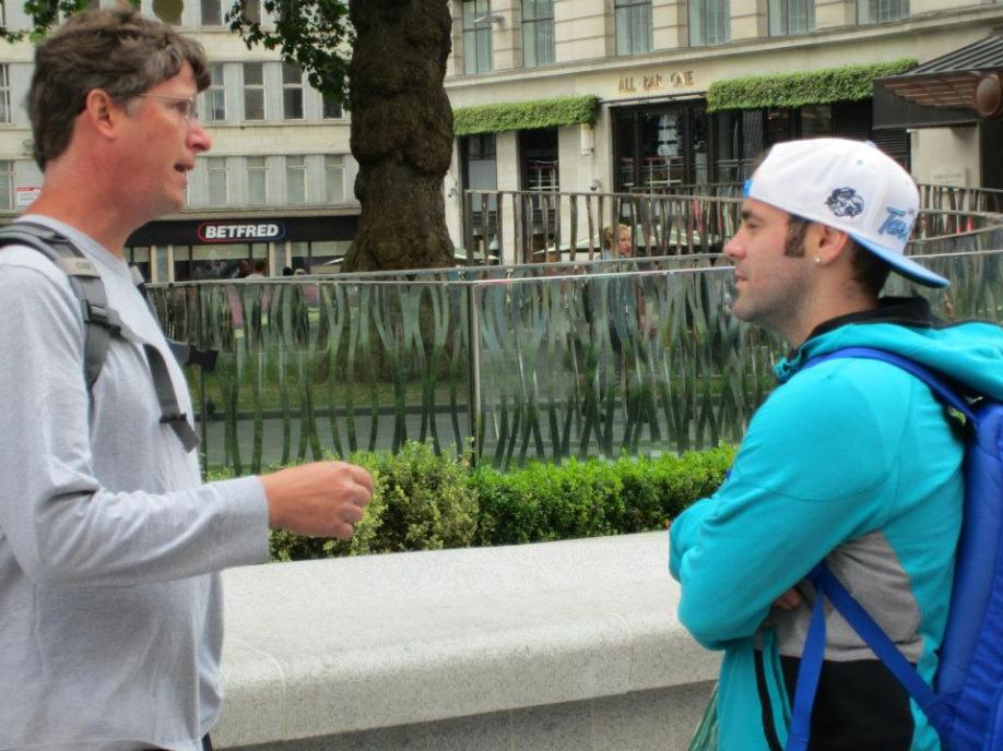 Jason engaging a young man in Leicester Square.