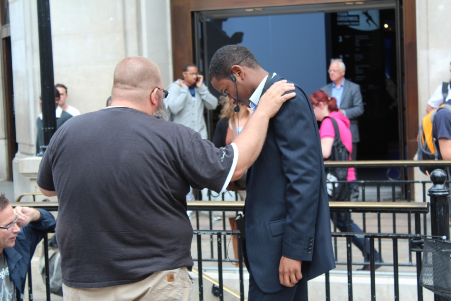 Bobby praying for Darren before he preaches.